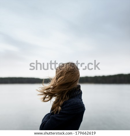 Art portrait of a girl in profile with no face with flying hair - stock photo