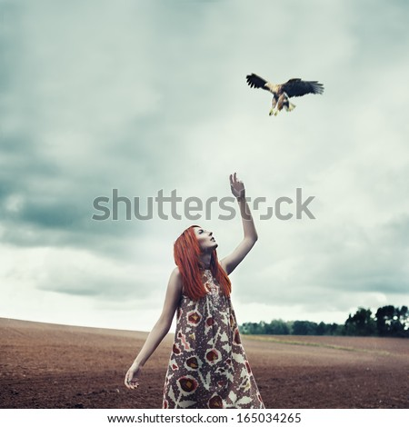 Art portrait of a girl in the rain with bird