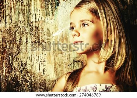 Art portrait of a pretty little girl wearing princess dress and elegant hat. Fashion shot. Childhood. - stock photo