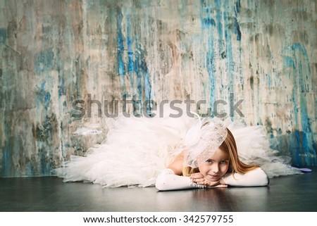 Art portrait of a pretty little girl wearing princess dress. Fashion shot. Childhood. - stock photo