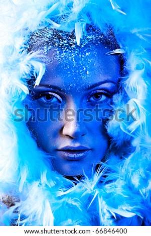 Art portrait of a snow female model in fur.  Fashion, beauty. - stock photo