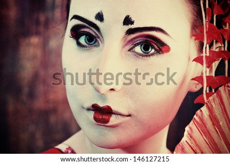 Art portrait of a stylized Japanese geisha. Body painting project.