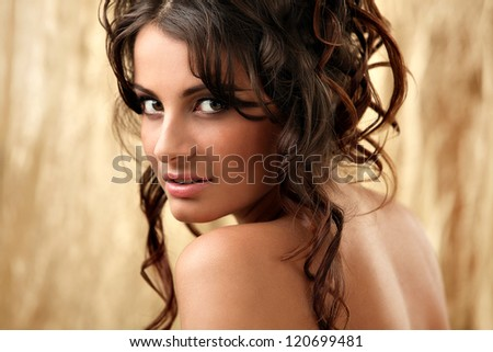 Art portrait of beautiful and attractive woman with curls over background