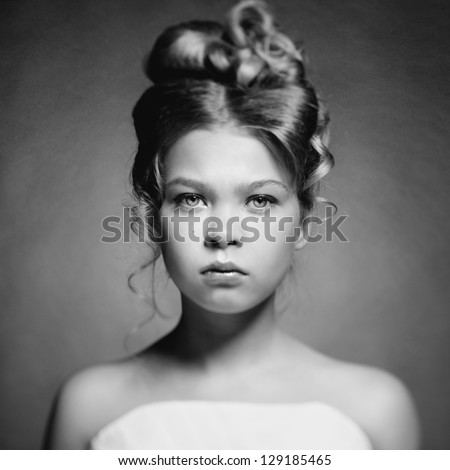 Art portrait of beautiful girl princess on black background