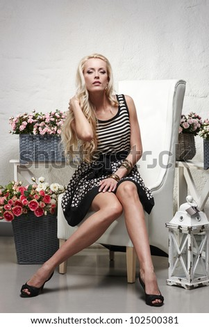 Art portrait of fashion model posing in the chair