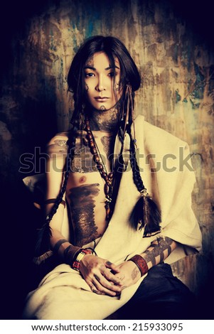 Art portrait of the American Indian. Ethnicity. Historical reconstruction.  - stock photo