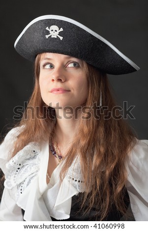Art portrait of the beautiful woman in an ancient piracy hat