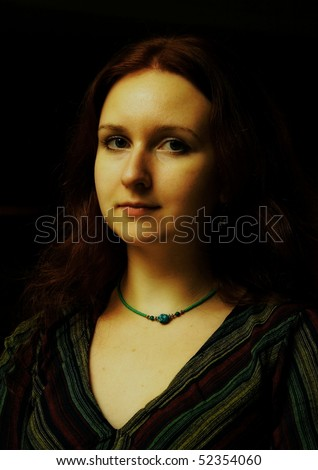 Art portrait of the girl on a dark background. Retro