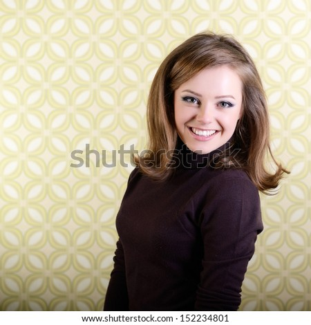 art portrait of young smiling ecstatic woman looking out at camera in room with vintage wallpaper, retro stylization 60-70s, toned and noise added - stock photo