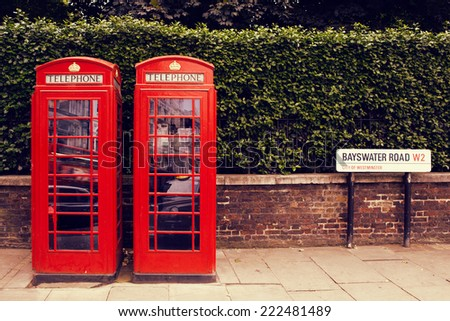 art row of traditional phone boxes in London city  - stock photo