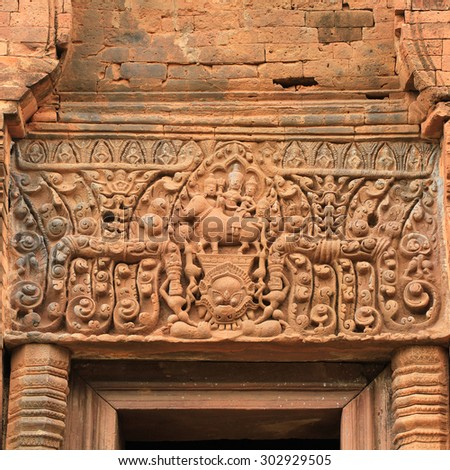 Art sandstone carvings in the ancient ornamental pediment above the entrance to the castle. Prasat Hin Phanom rung  Historical Park, sand stone castle in Buriram, Thailand. - stock photo