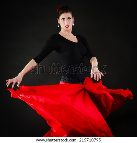 Art. Sexy spanish girl attractive woman in red long skirt dancing flamenco traditional dance. - stock photo