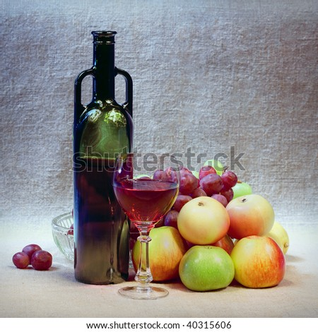 Art still-life from wine, grapes and apples against a sacking - stock photo