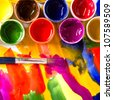 art studio paints, palette, brush - stock photo