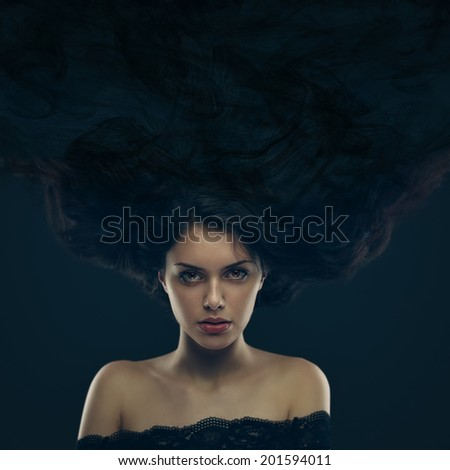 Art studio portrait of young gorgeous brunette girl - stock photo