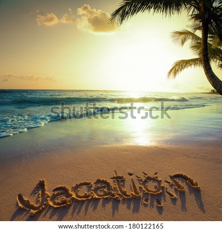 Art Summer vacation concept--vacation text on a sandy ocean beach  - stock photo