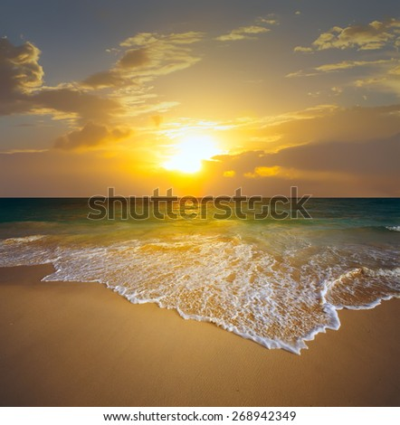 art sunset over the beach - stock photo
