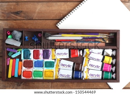 Art Supplies and Blank Sketch Pad - stock photo