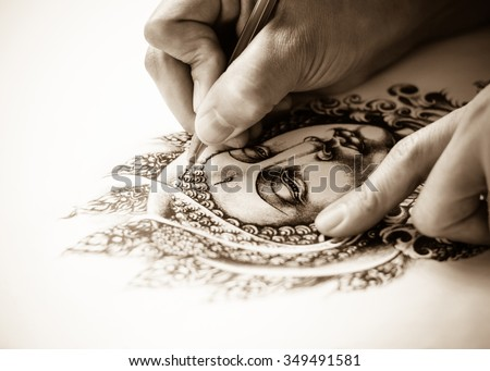 Art tattoo designs are hand drawn image of Buddha sepia color tone . As for the tattoo. Belief and faith in Buddhism. Drawing on white paper. - stock photo