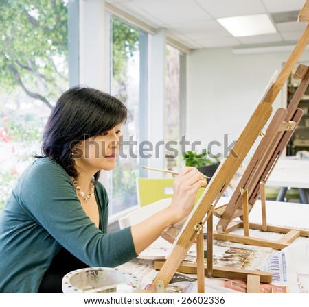 Art teacher painting - stock photo