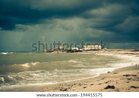 Art toned image of  fisherman shack with stormy skies. Crimea. - stock photo