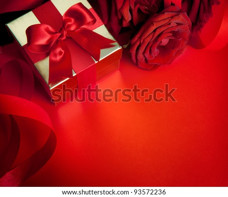 art valentines greeting card with red roses and gift box isolated on red background - stock photo