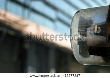 Artful shot of an electric meter against urban setting - stock photo