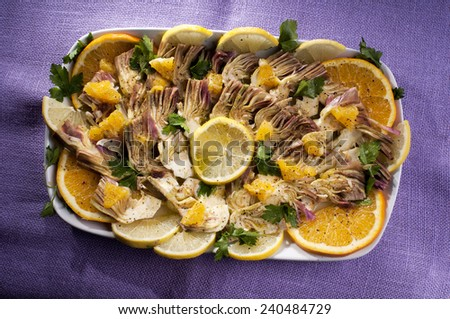 artichoke carpaccio with raw marinated artichokes  oil lemon salt pepper - stock photo