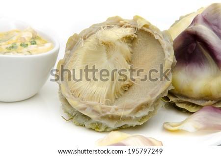 Artichoke hearts with a vinaigrette, isolated on white - stock photo