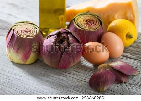 Artichokes, Eggs, Lemon, Olive Oil and Parmesan - stock photo