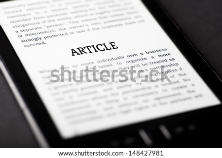 Article on tablet pc touchpad, ebook concept - stock photo