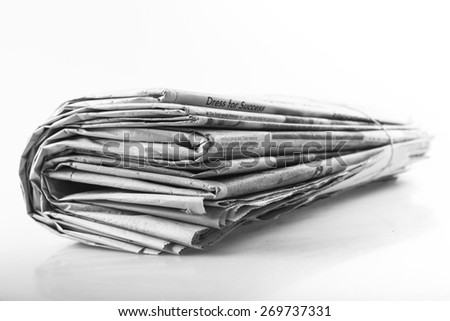 Articles. Newspaper with news closeup on white background - stock photo