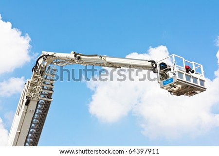 Articulated aerial hydraulic platform against a blue sky - stock photo