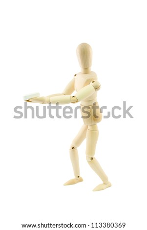 articulated wooden dummy giving a pill, isolated on white background