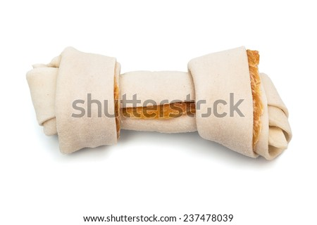 Artificial a bone for a dog with vitamins - stock photo