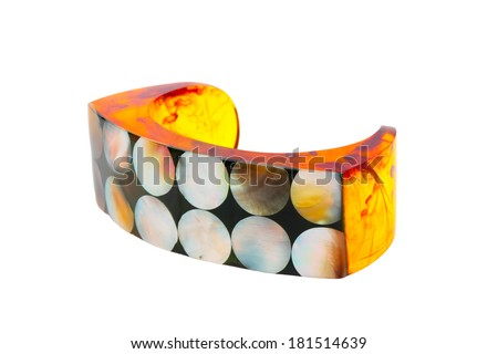 Artificial amber bracelet with nacre isolated on white background - stock photo