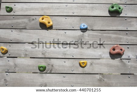 Artificial climbing wall / Climbing wall for practicing / Rock climbing wall - stock photo