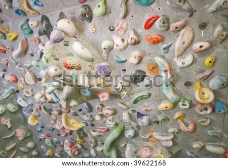 Artificial climbing wall indoor - stock photo