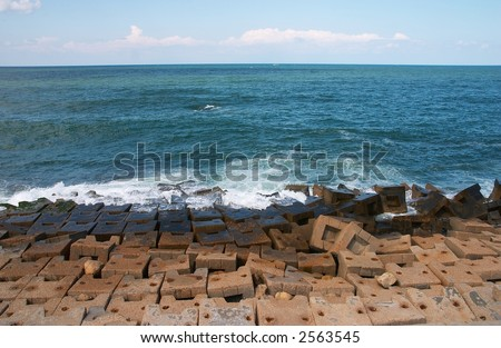 Artificial coast from concrete of Protected stone blocks - stock photo