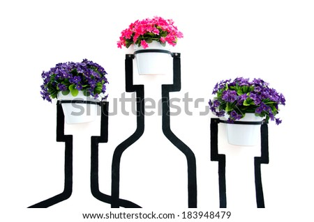 Artificial colorful flowers pots hang onto the wall with vase painting - stock photo