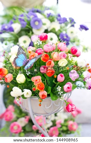 Artificial Decorated Flowers. - stock photo