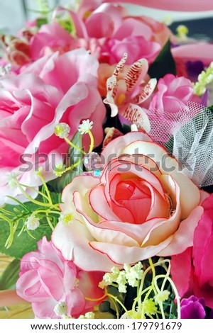 Artificial fabric rose flower in a bouquet - stock photo