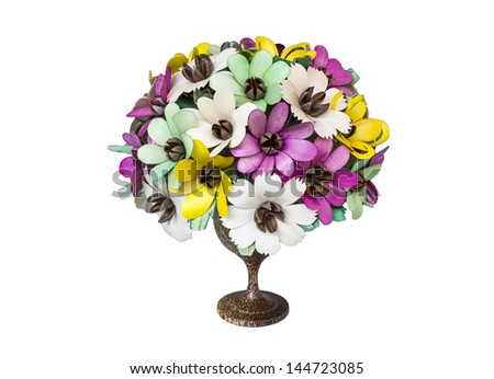 Artificial flower in vase of wood. - stock photo
