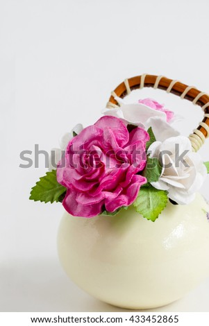 Artificial flowers, colorful vases on a white background.