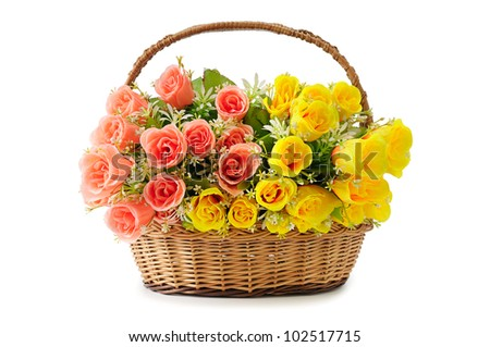 artificial flowers in basket isolate on white - stock photo