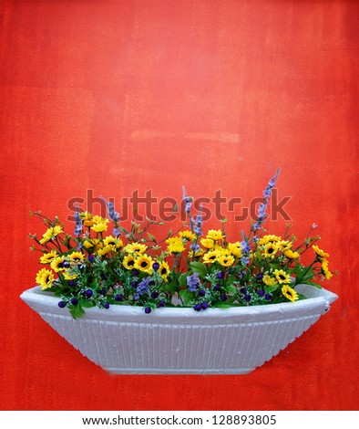 Artificial flowers on a red background - stock photo