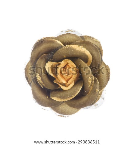 Artificial gold flower isolated on white background