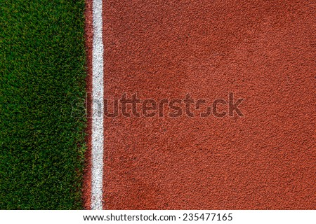Artificial grass and run track texture in a stadium - stock photo