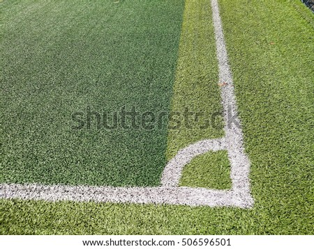 Artificial grass field with white line