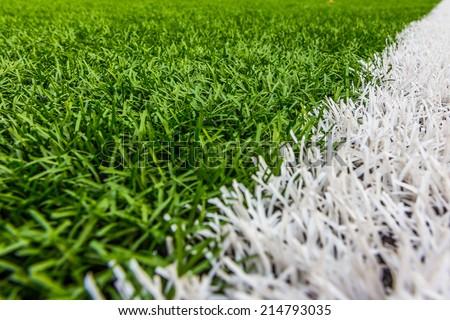 Artificial grass with white stripe, Football Stadium - stock photo
